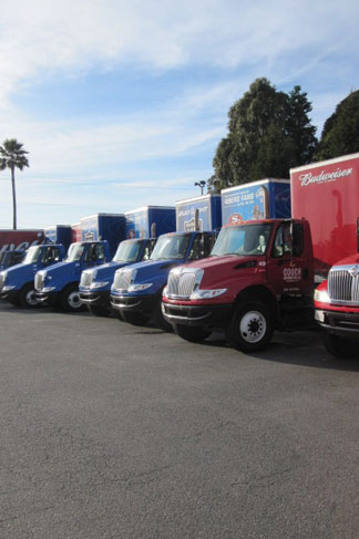 Delivery trucks lined up.